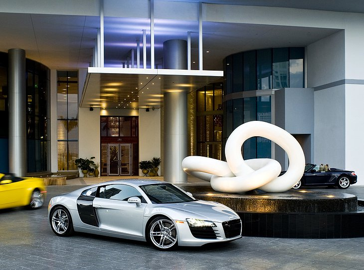 Epic hotel entrance with supercars parking in front