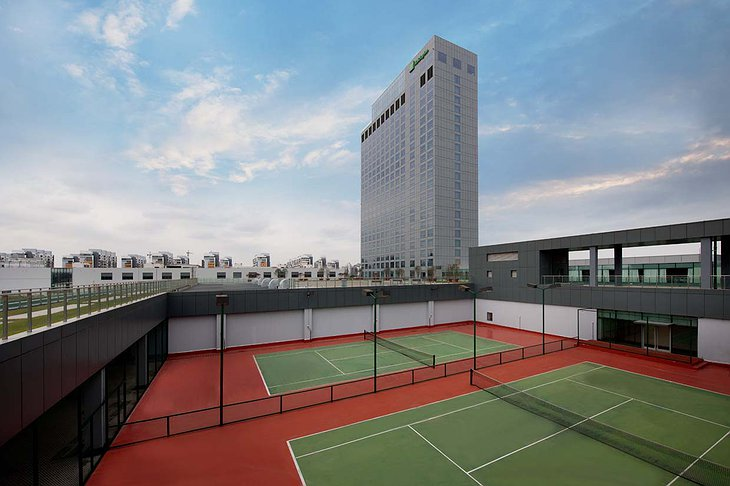 Tennis courts and Holiday Inn Shanghai Pudong Kangqiao