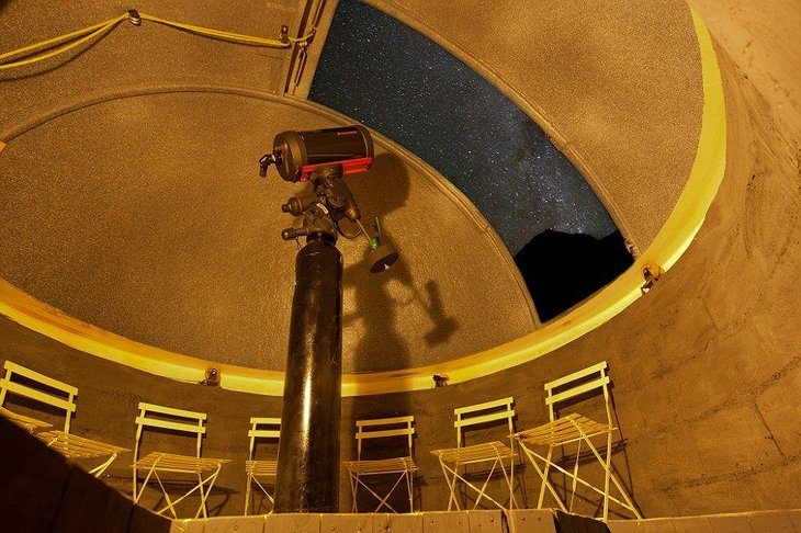 Gazing at the stars with the telescope from inside the tent of Elqui Domos