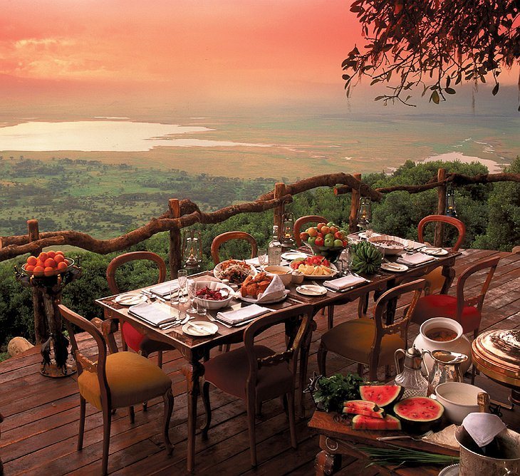 Dining on the terrace with spectacular views at Ngorongoro Crater Lodge