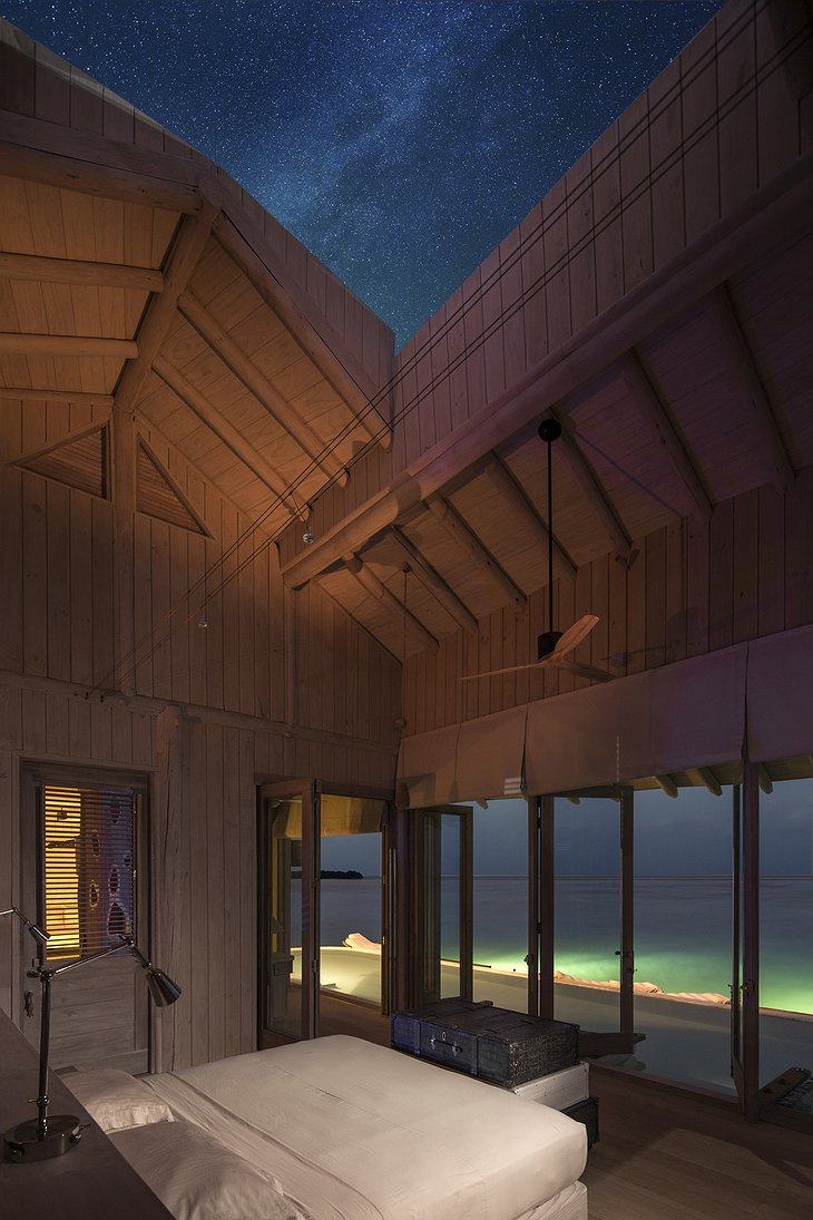 Soneva Jani Maldives villa bedroom with open roof to sky at night