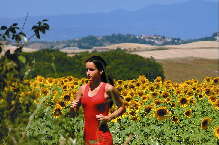 Girl running in the Tuscan nature