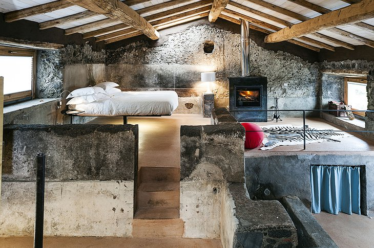 Monaci delle Terre Nere stone wall suite with fireplace