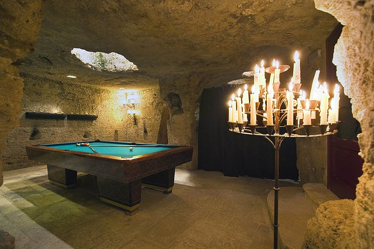 Billiard in the cave of Masseria Torre Coccaro hotel