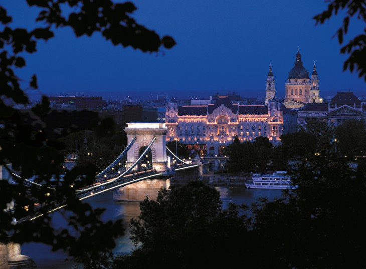 Budapest at night with the Chain Bridge lit up and the Four Seasons Hotel Gresham Palace in the background