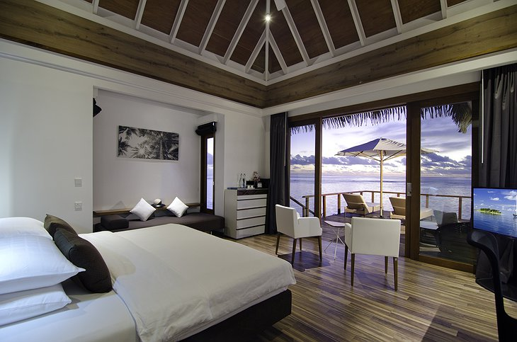 Kandolhu Island water villa bedroom