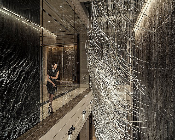 Four Seasons Hotel Pudong interior design details examined by a classy lady in black dress