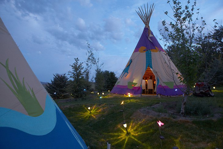 Mustang Monument Resort tipis at night with small lights on the ground