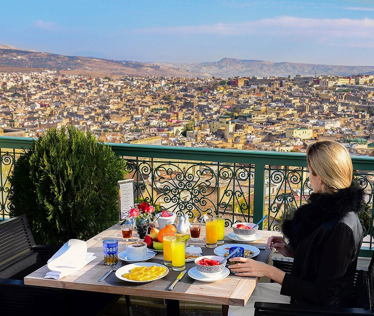 Palais Faraj terrace dining with Fes old town panorama
