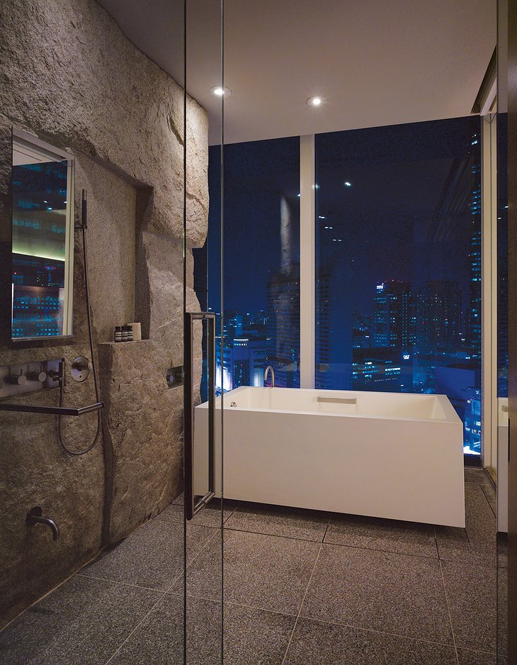Park Hyatt Seoul deluxe bathroom at night with panorama on the city