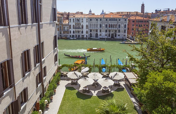Aman Venice Grand Canal Hotel garden at the canal