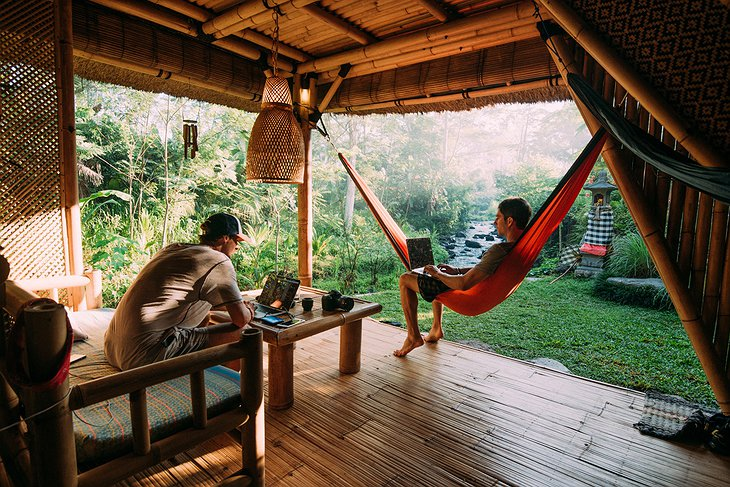 Guys chilling in the hammock at the Hideout Bali bamboo house