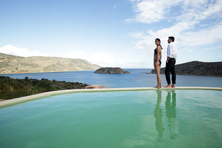 Domes of Elounda couple at the edge of the private pool