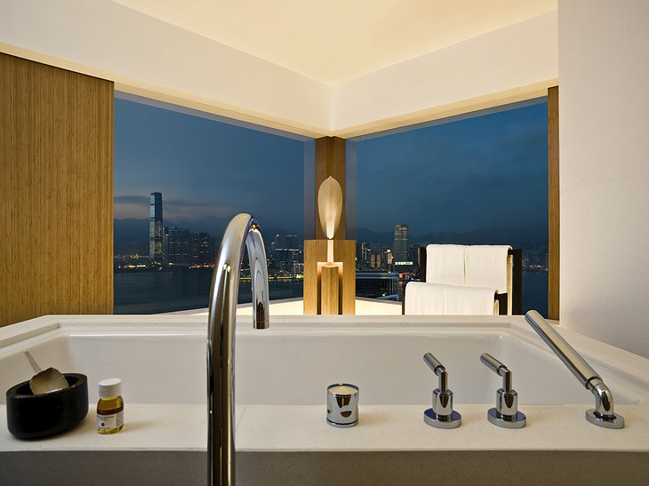 The Upper House hotel bathroom with views at night