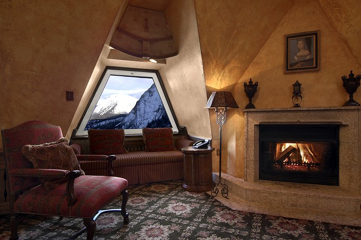 Fairmont Banff Springs Hotel room with fireplace and view on mountains