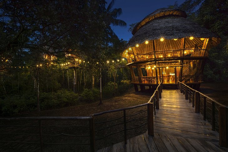 Treehouse Lodge Iquitos main building with restaurant at night