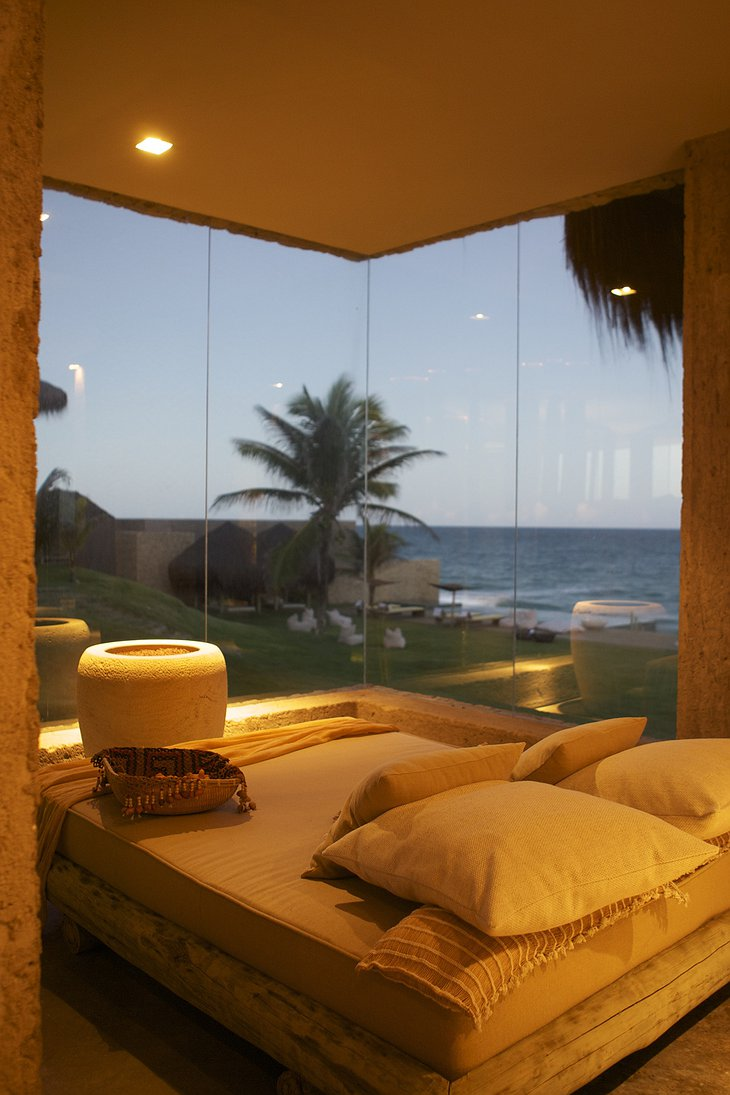 bedroom with bottom to ceiling glass with sea view
