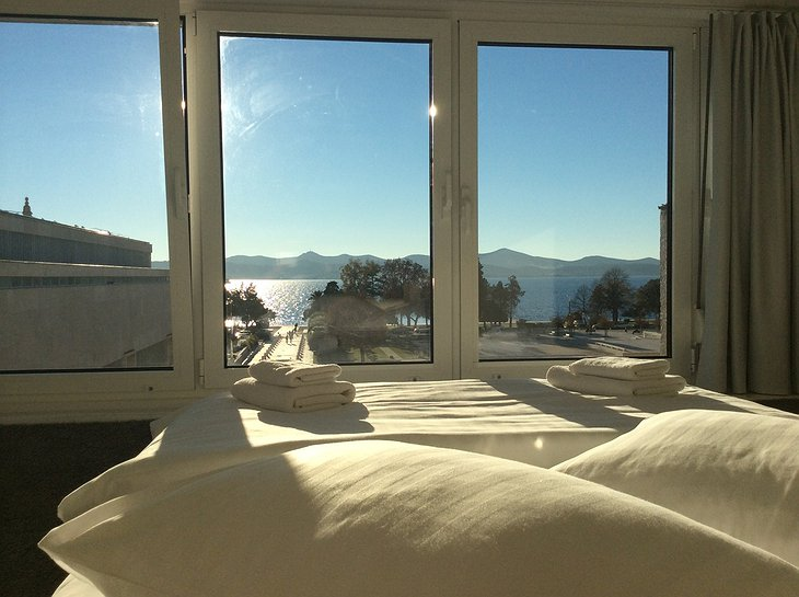 Boutique Hostel Forum lux white room panorama from bed on Zadar