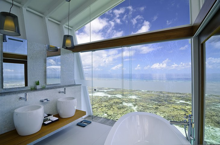 Kandolhu Island water villa bathroom with sea views