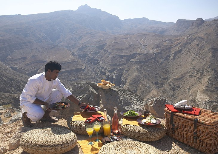 Preparing the meal on the top of the rocky hills of Oman