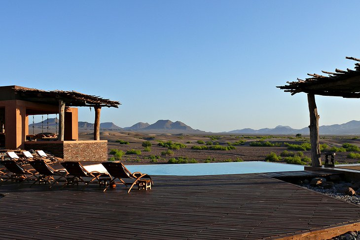 Okahirongo Elephant Lodge infinity pool with panorama on the nature
