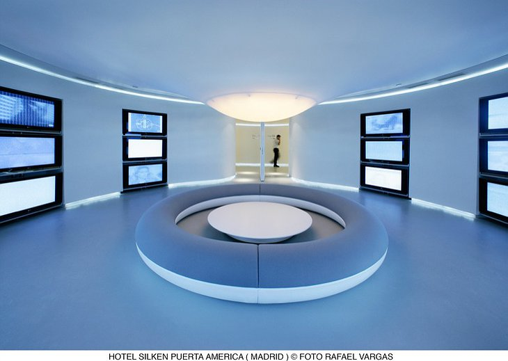 Futuristic waiting room with plasma TVs at Hotel Silken Puerta América Madrid hotel
