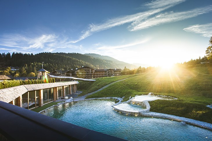 Green Spa Resort Stanglwirt Outdoor Pool with Slide and Mountain View