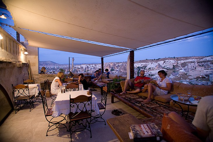 Kelebek Cave Hotel rooftop terrace with people enjoying in the evening