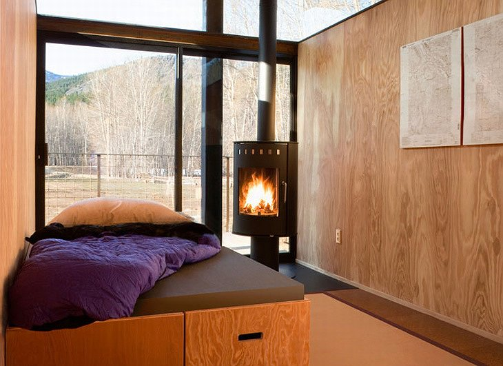 Rolling Huts bedroom with fireplace