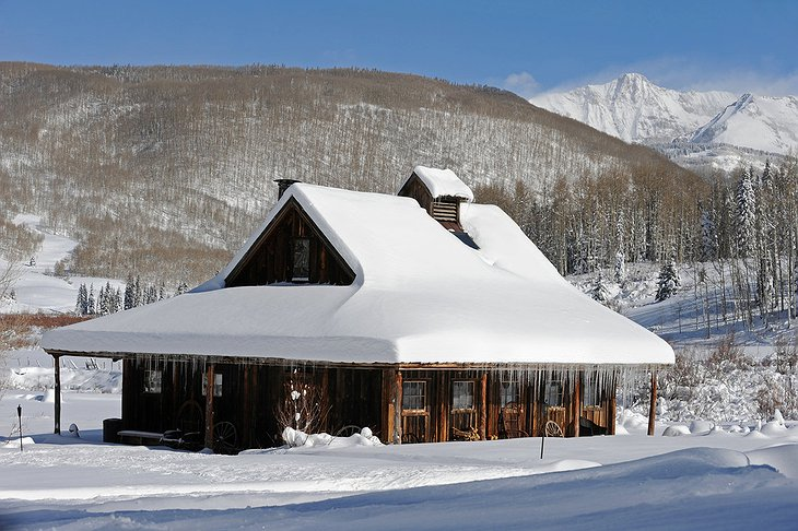 Dunton Hot Springs wooden house under the snow