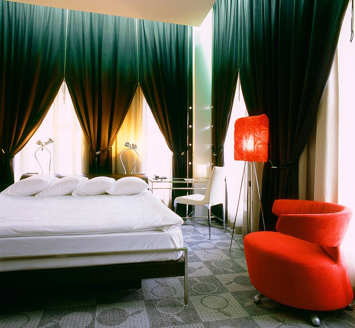 Golden Apple Hotel red deluxe room