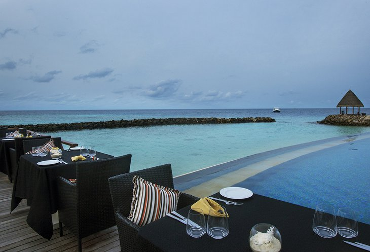 Vivanta By Taj - Coral Reef dining with pool and ocean views
