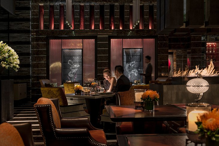 Four Seasons Hotel Pudong evening dining with fireplace
