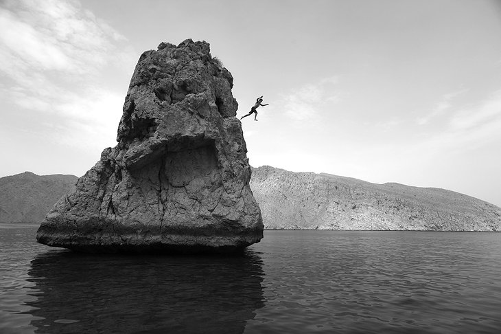 Jumping from the rocks in Zighy Bay