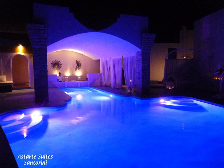 Infinity pool at night at Astarte Suites Hotel