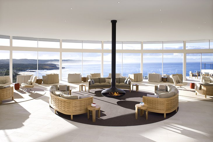 Southern Ocean Lodge common room with fireplace and breathtaking view on the sea