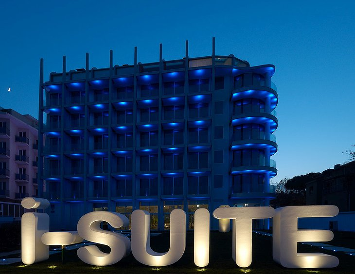 i-Suite Hotel Rimini building with neon sign