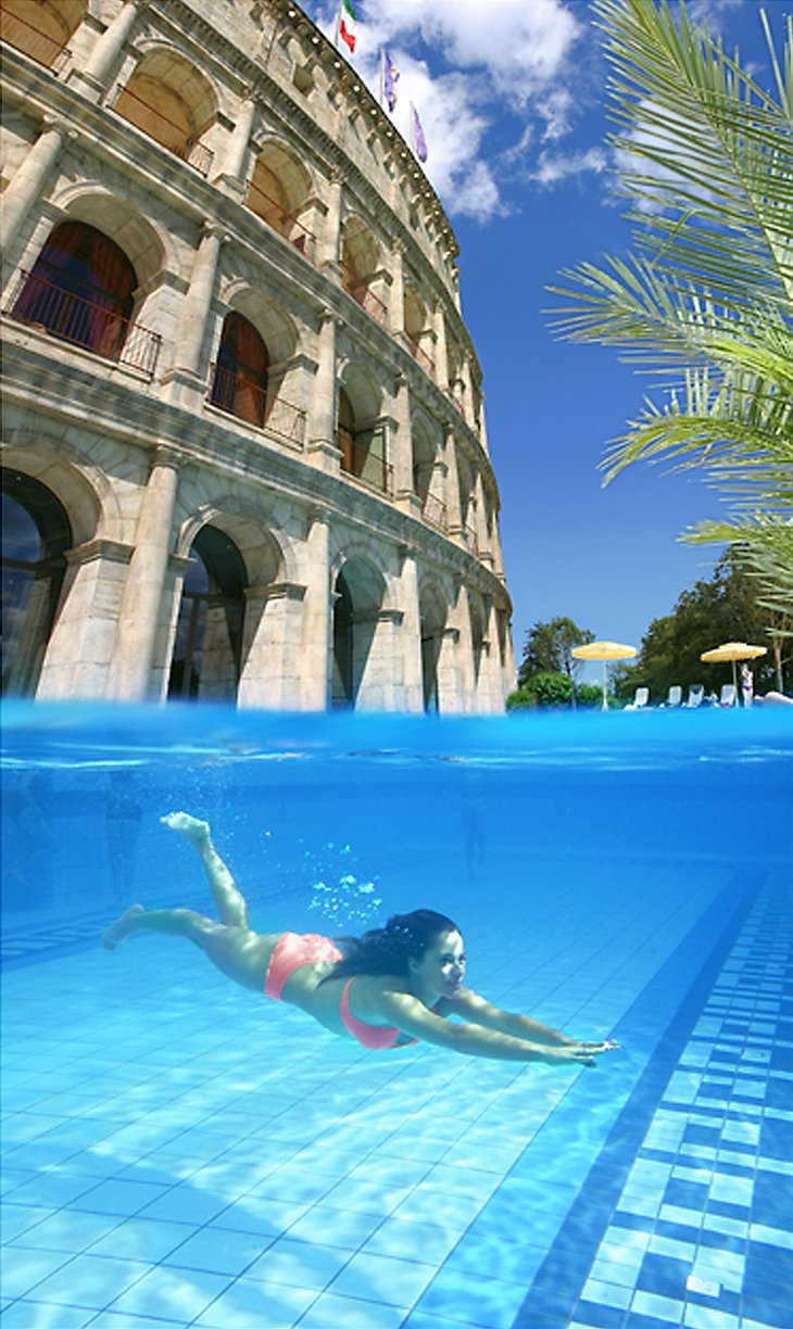 Girl under water in the swimming pool of the Colosseum hotel