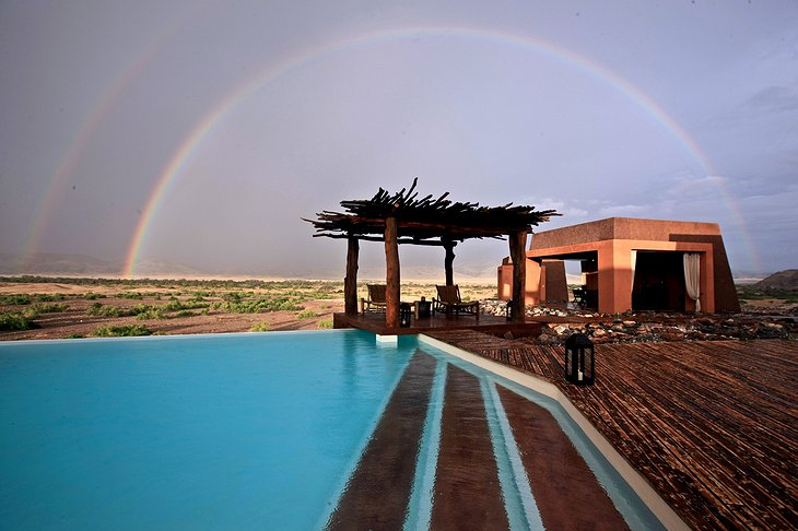 Okahirongo Elephant Lodge pool with rainbow
