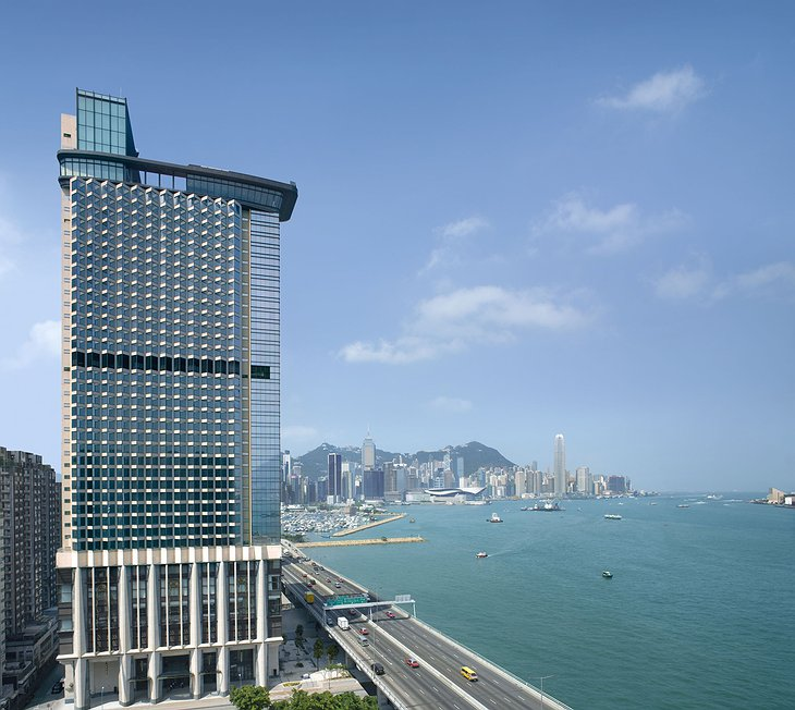 Harbour Grand Hong Kong exterior of the tower with Hong Kong skyline