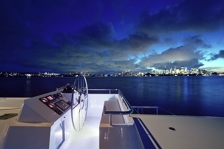 Necker Belle at night with city skyline