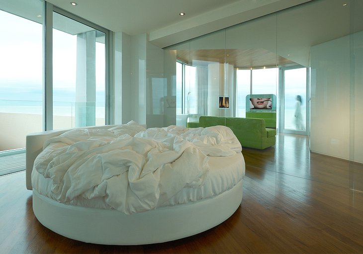 Penthouse suite with rounded bed