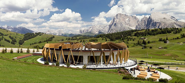 Alpina Dolomites hotel with garden and mountains around