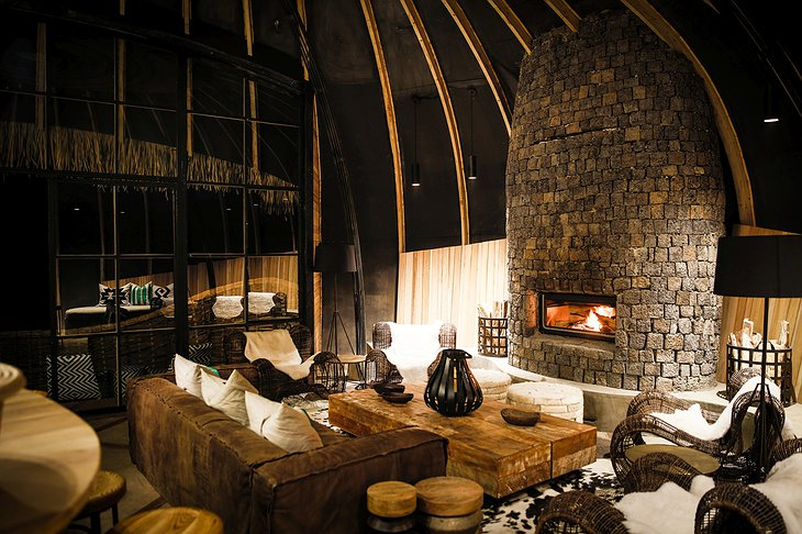 Bisate Lodge cozy interior with fireplace
