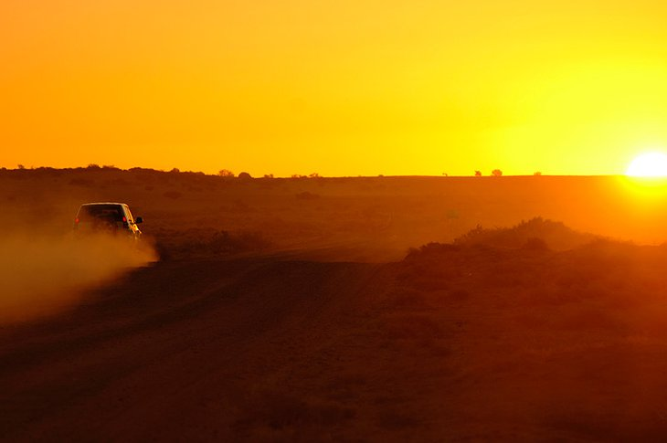 Toyota Land Cruiser in the desert at sunset