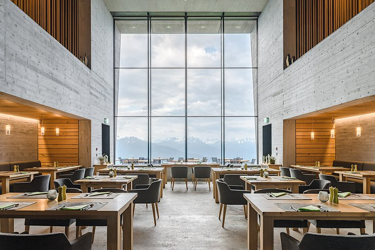 Hotel Chetzeron restaurant with giant floor to ceiling windows with view to the Alps