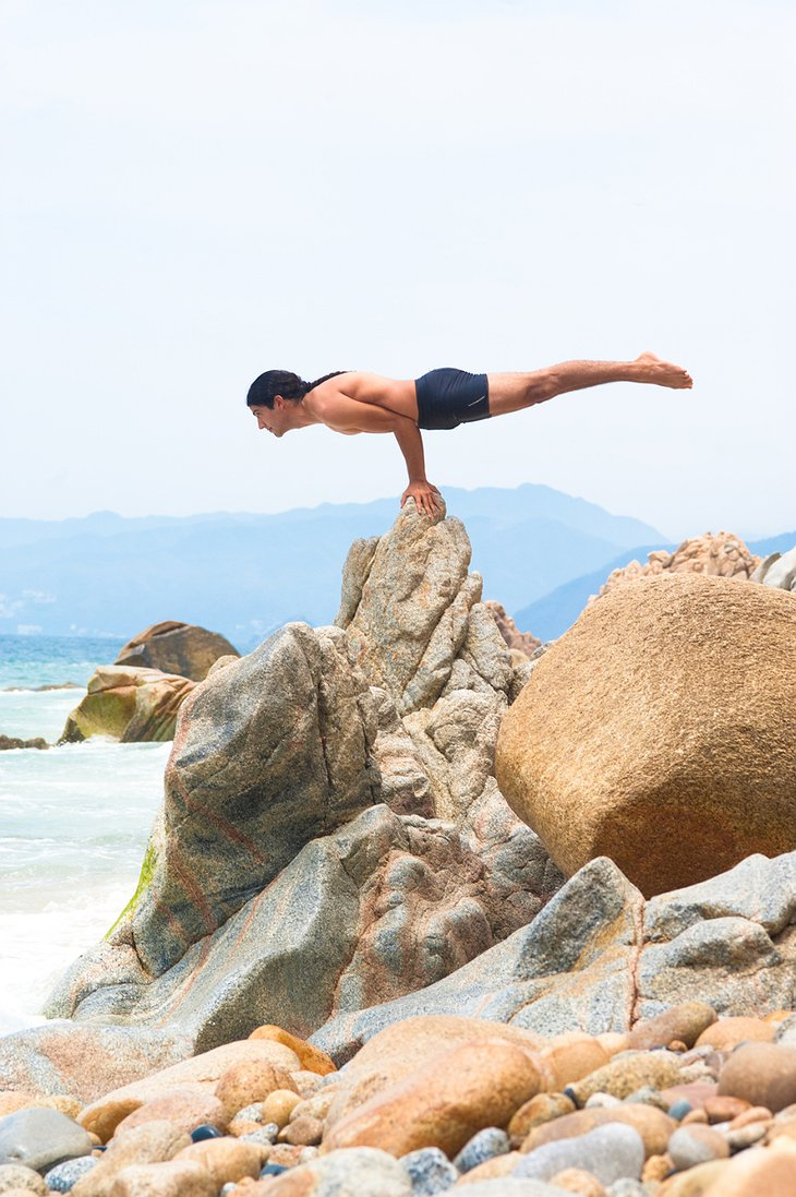 Extreme yoga on the beach