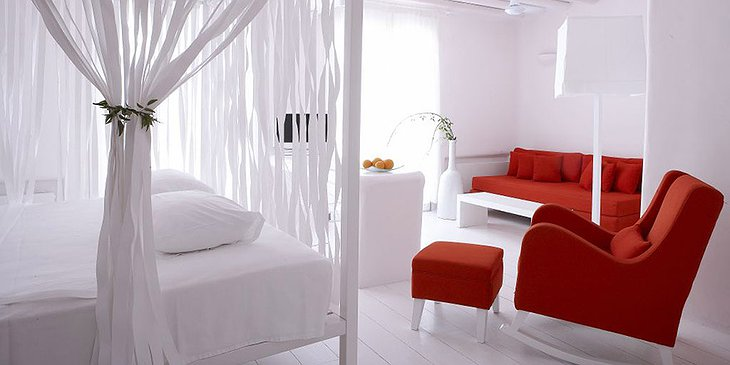 Cavo Tagoo white room with red furniture