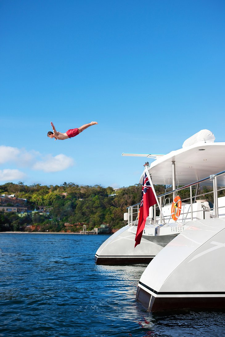 Jumping from the dock of Necker Belle yacht