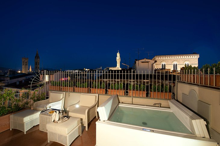 Pool suite by night with jacuzzi